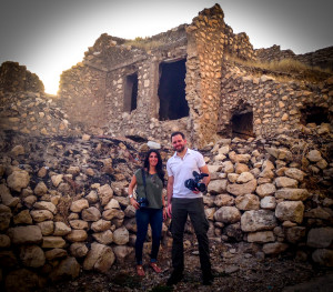OLS producers Helma Adde and Jordan Allott stand in front of ancient remains in the village of Alqosh, Iraq.
